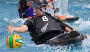 new zealand women dribbling determination picking up ball icf canoe polo world games 2017